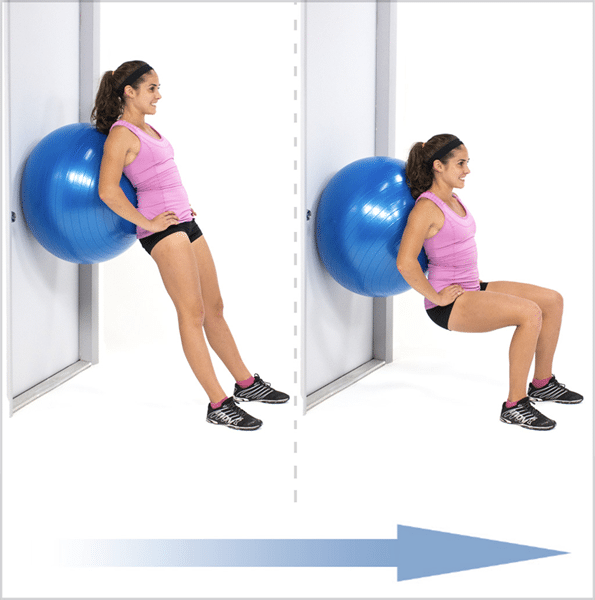 Woman using an exercise ball to perform the wall sit exercise.