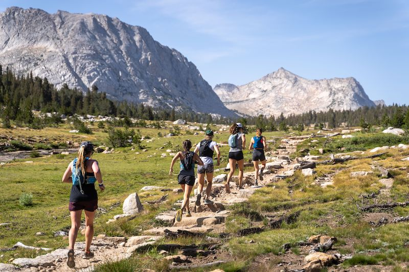 Female trail runners running on a trail in Yosemite National Park.